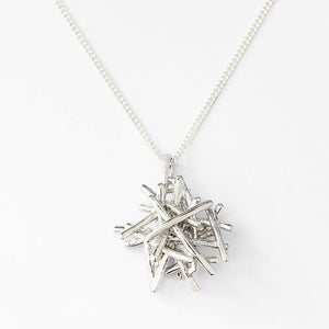 a sterling silver fire stack design pendant which is solid on a fine curb link silver necklace