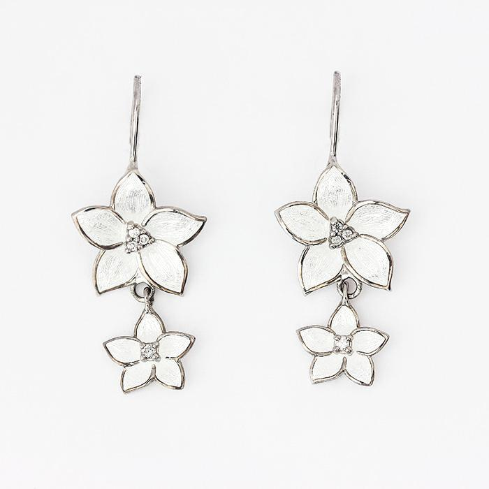 silver flower drop earrings with hook fittings and white enamel petals with small diamonds in the centre