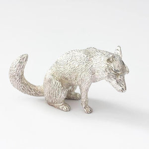 a solid silver sitting fox having a wash and all british made with hallmark