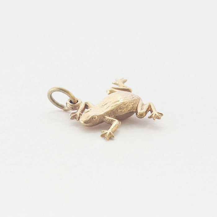 a fine quality small frog charm in yellow gold