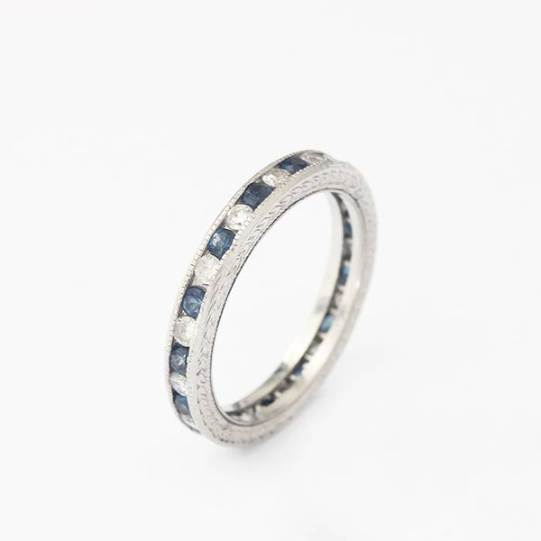 a fine quality beautiful sapphire and diamond full eternity ring in white metal with grain setting