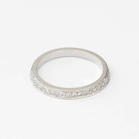 a platinum diamond set full eternity ring with round brilliant cut diamonds