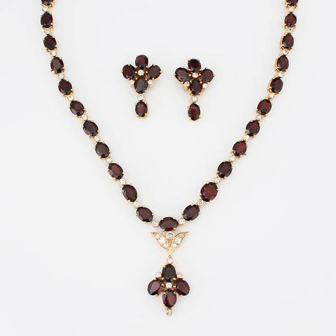 a garnet and diamond necklet with yellow gold settings and matching floral earrings