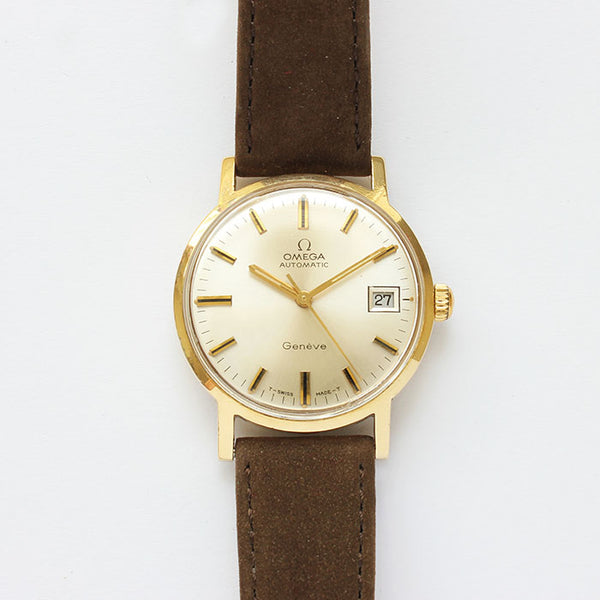 an excellent vintage omega automatic geneve mens watch with brown strap and original box and papers