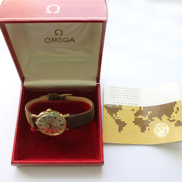 a fine quality omega mens watch geneve automatic movement gold case and box with papers