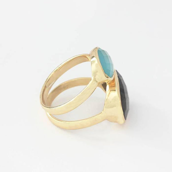a modern labradorite and blue calcite two stone ring with large oval stones in a yellow gilt silver metal size M and a half