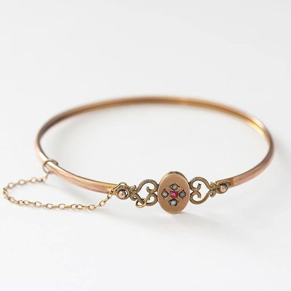 an antique ruby and pearl gold delicate bangle with safety chain