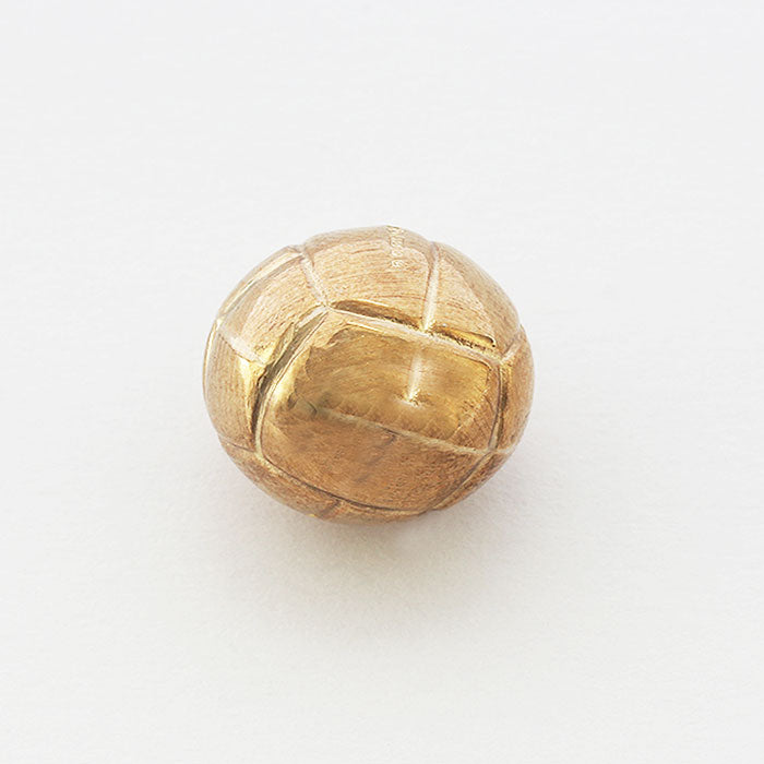 a detailed yellow gold football vintage charm