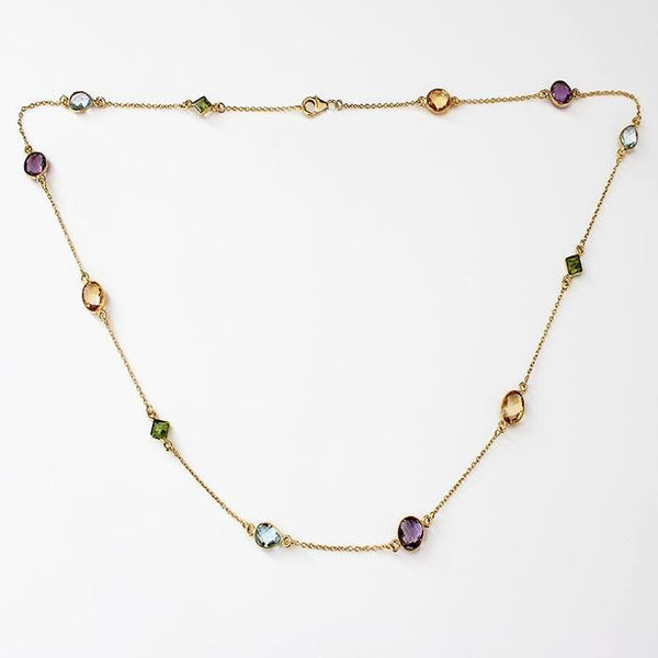 a multi stone long chain with silver gilt and amethyst and citrine and blue topaz and peridot stones equally spaced