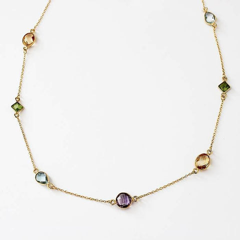 a silver gilt modern long necklace with amethyst and citrine and peridot and blue topaz