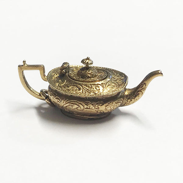 an engraved secondhand vintage 9 carat yellow gold teapot charm which opens