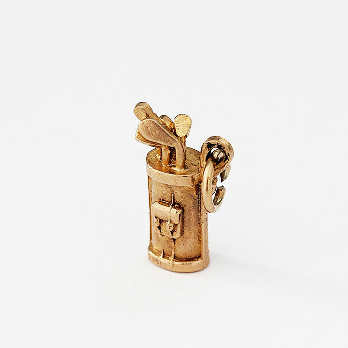 a secondhand yellow gold golf bag and clubs charm in 9ct