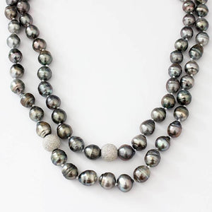 a long rope of grey cultured Tahitian pearls with 2 sparkly beads in between