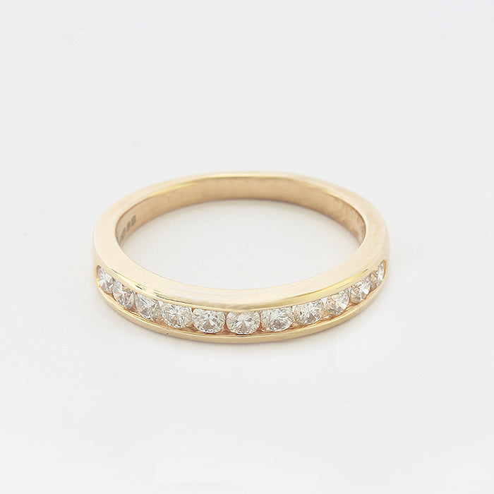 eleven stone round diamond channel set half eternity ring in yellow gold