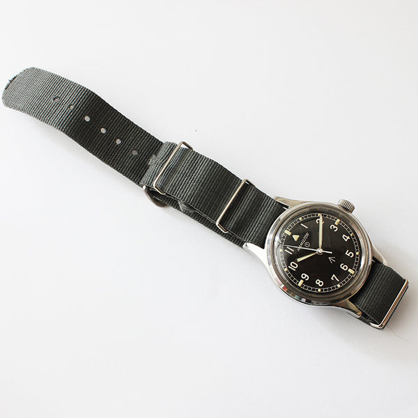 a vintage Hamilton RAF issue mens wrist watch with black dial and steel case and fabric strap
