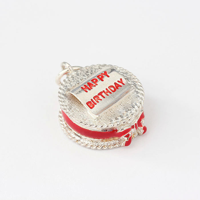 happy birthday cake charm in silver with red enamel