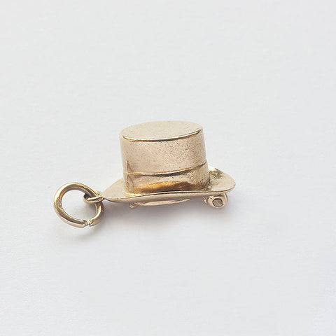 a gold hat hinged charm with rabbit inside