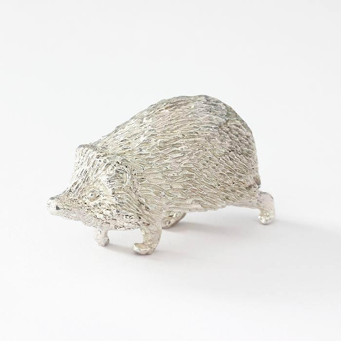 sterling silver solid running hedgehog ornament with great detailing and full hallmark and british made