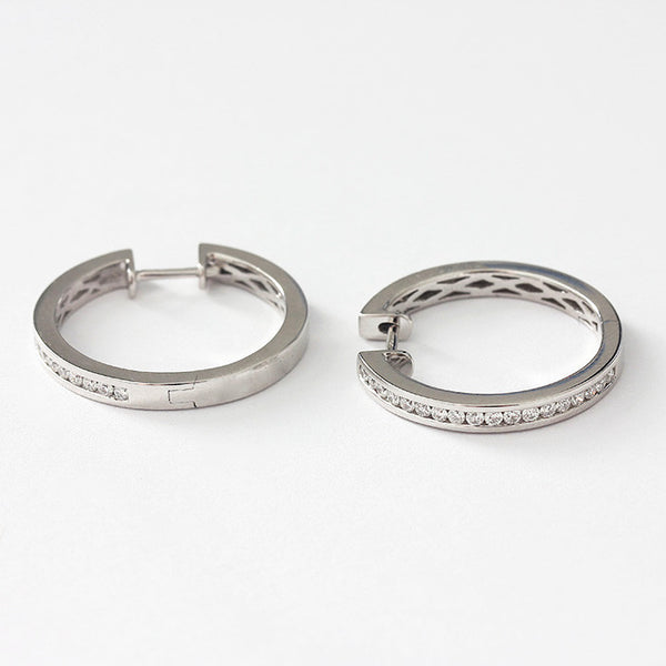 diamond set hoop earrings in 18ct white gold with a post and hinge