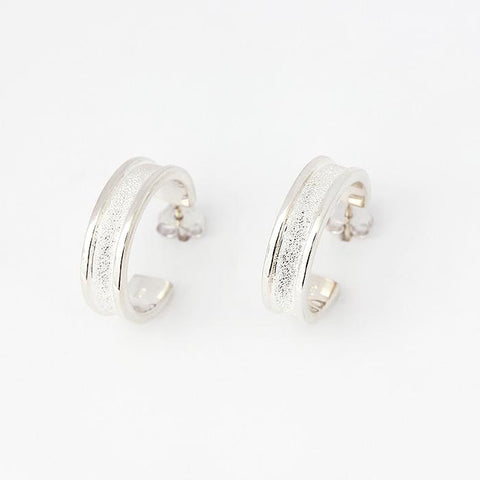 silver hoops with a diamond cut centre and polished edge 20mm diameter