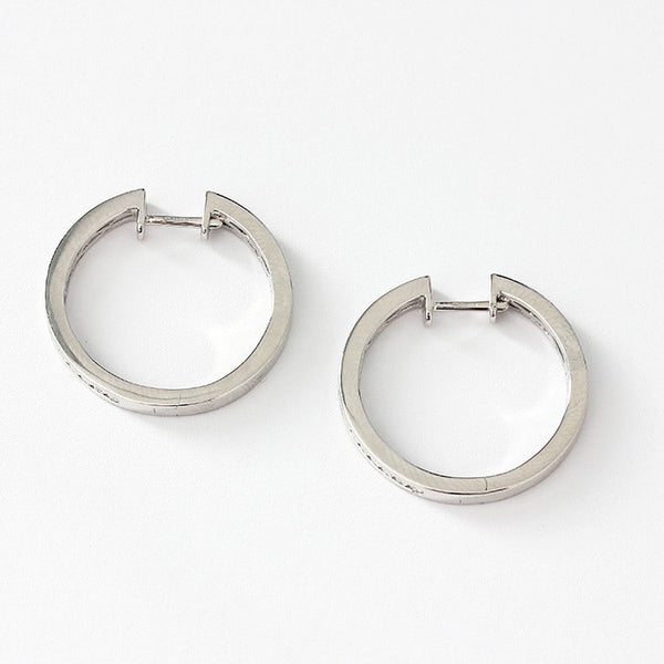 18ct white gold hoop earrings 22mm diameter with diamonds set in a channel half way round