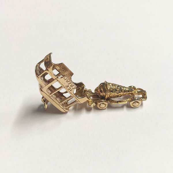a vintage secondhand ice cream gold charm which opens up with an Ice cream inside