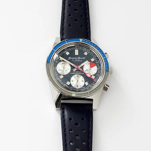a vintage jacques monnat mens watch with stainless steel dial and multi functions with leather strap