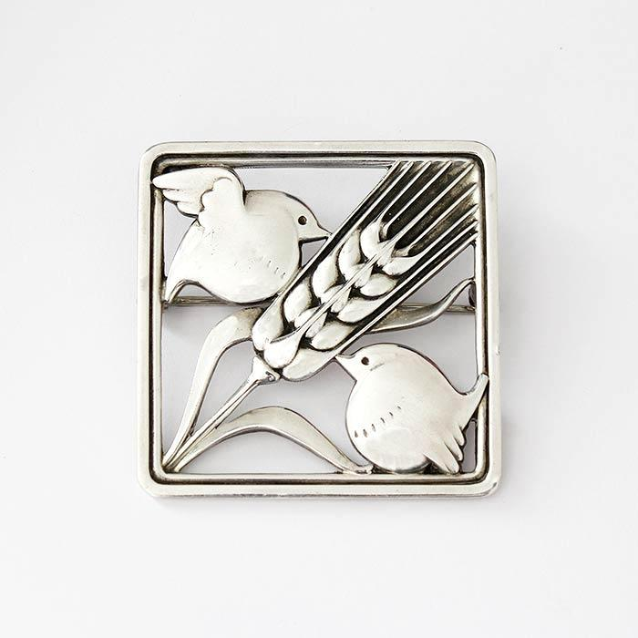 a vintage Georg jensen birds and wheat sheaf silver brooch with original box, dated 1975