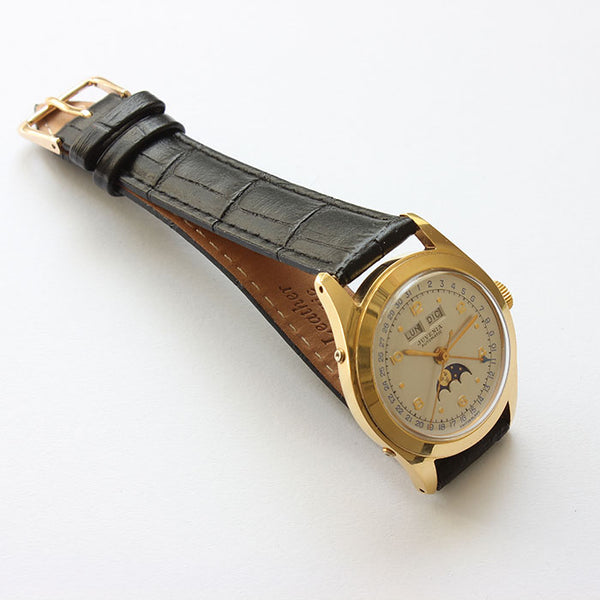 a superb juvenia vintage mens watch with black strap and moon and calendar feature