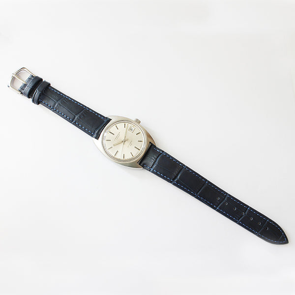 j w benson vintage mens watch with white dial and batons and steel case and blue leather strap dating back to 1970s with original box