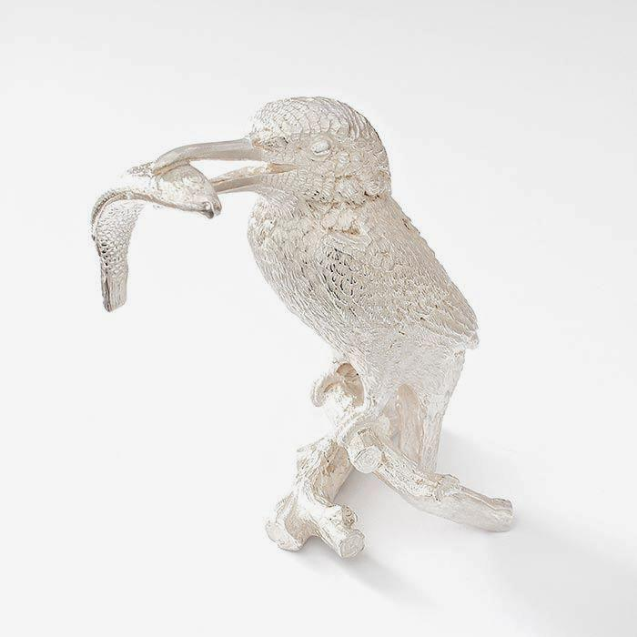 a heavy solid silver large kingfisher figure with fish with great detailing and british made with hallmark