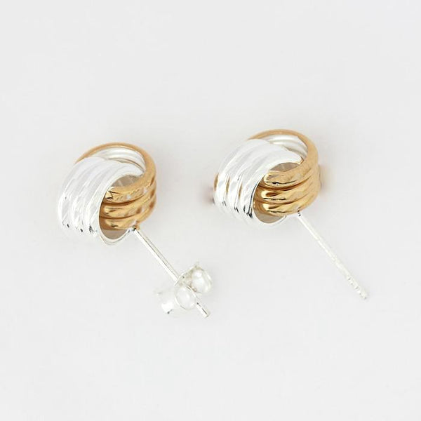 silver knot design earrings with gold plating sections