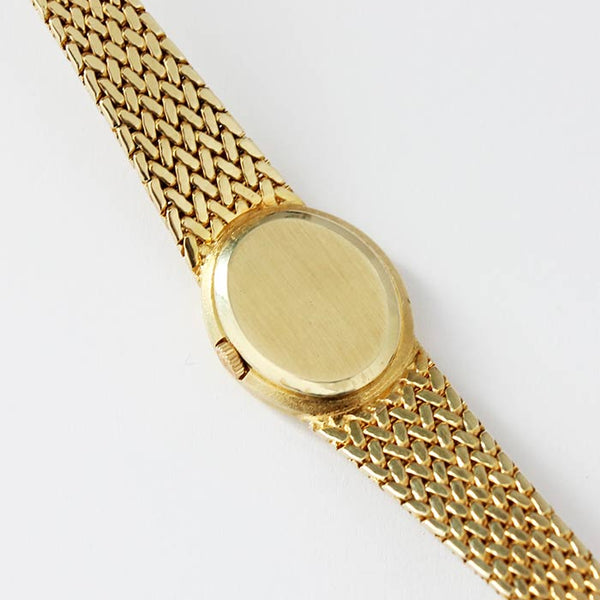 a secondhand ladies rolex watch in yellow gold with plain batons and a gold bracelet 1990s model