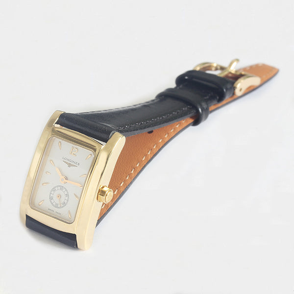 a gold ladies longines vintage watch with leather strap