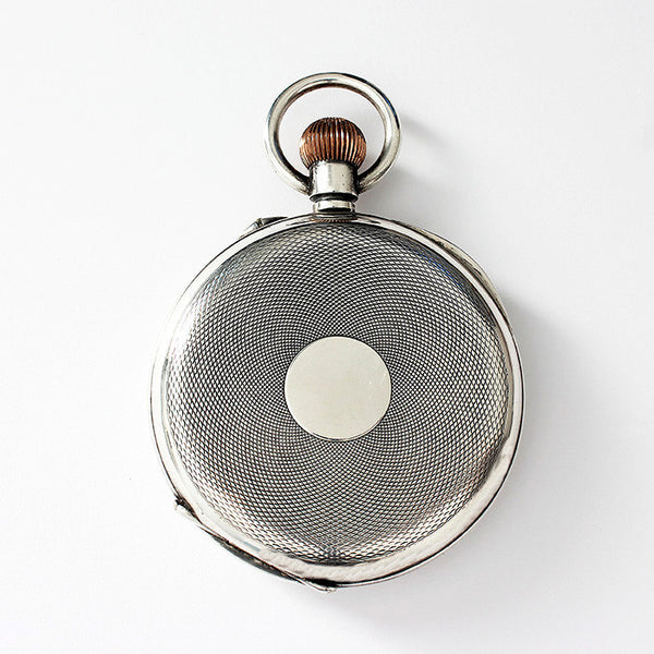 a large secondhand pocket watch in silver and engraving inside