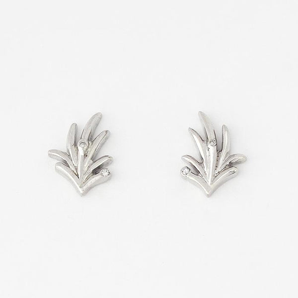 leaf pattern set of silver earring studs with 2 small diamonds set within with a post and butterfly fitting