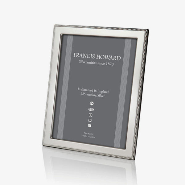 silver photo frame with a outer beaded edge and a wooden back made in sheffield