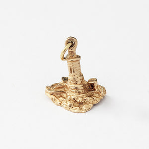 a vintage lighthouse charm in 9ct yellow gold and a full hallmark for a charm bracelet