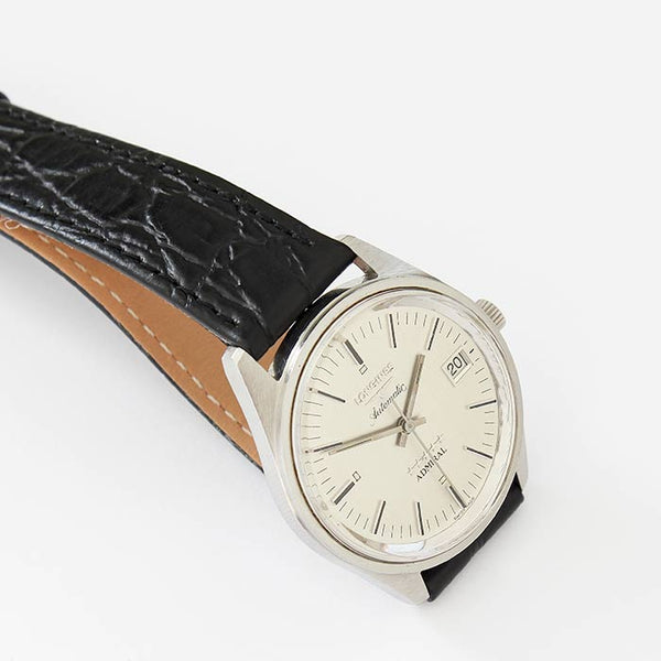 a vintage secondhand gents longines automatic watch with stainless steel case and leather strap with date feature