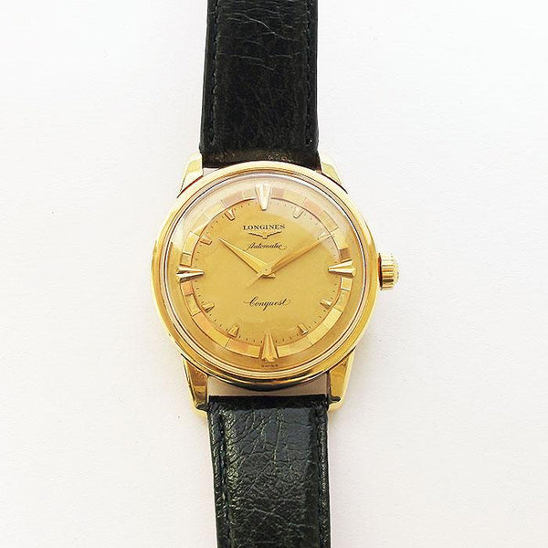 a fine quality vintage mens longings watch with green strap and gold case and original box dated 1956