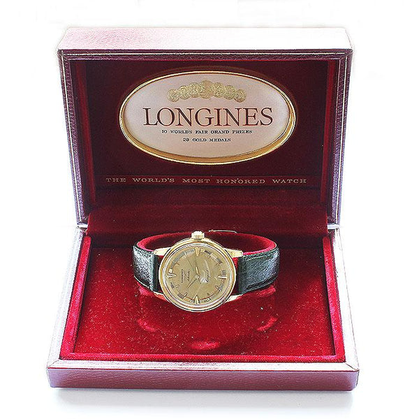 a vintage longines mens watch original box green strap dated 1956 gold case