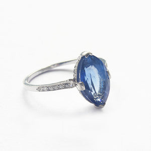 a marquise cut sapphire with diamond shoulders ring in platinum