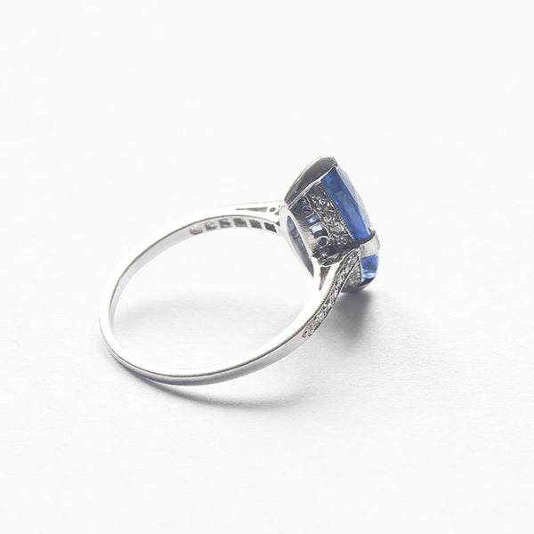 a secondhand platinum ring with a marquise cut sapphire and diamond shoulders