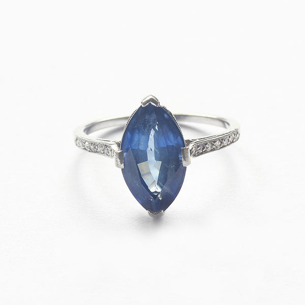 a secondhand platinum sapphire marquise ring with diamonds