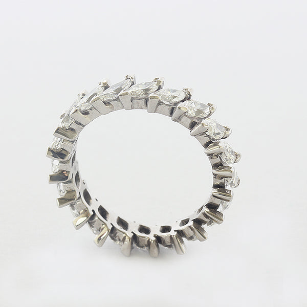a full eternity ring in white gold with marquise diamonds all the way round