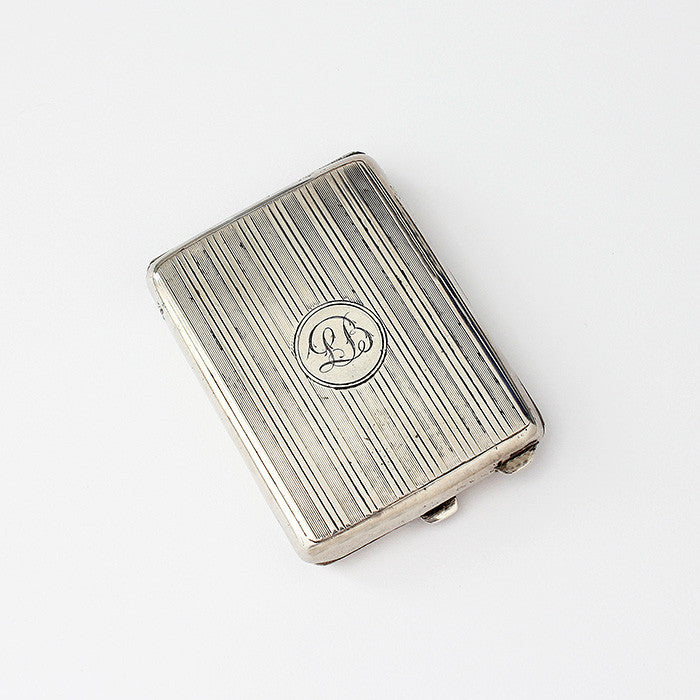 a silver vesta case with engraving and engine turned pattern with matches inside dated 1921