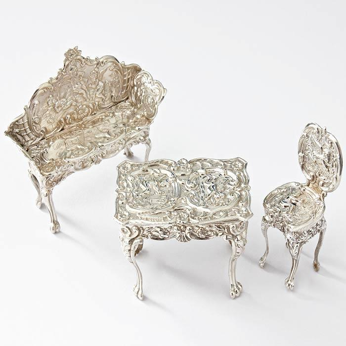 a sterling silver miniature dolls house furniture set chair table and sofa all hallmarked birmingham 1901