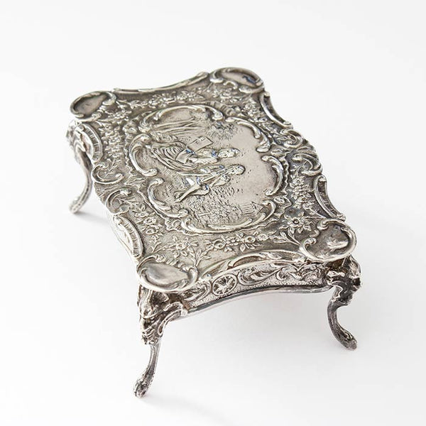 a beautiful sterling silver miniature dolls house table with an engraved scene dated and hallmarked london 1901