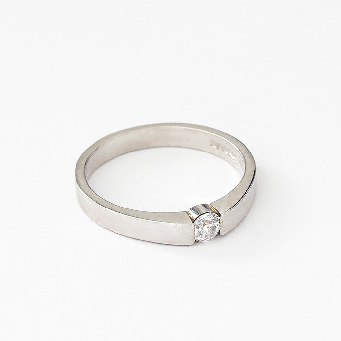 a diamond single stone ring in platinum with a tension setting