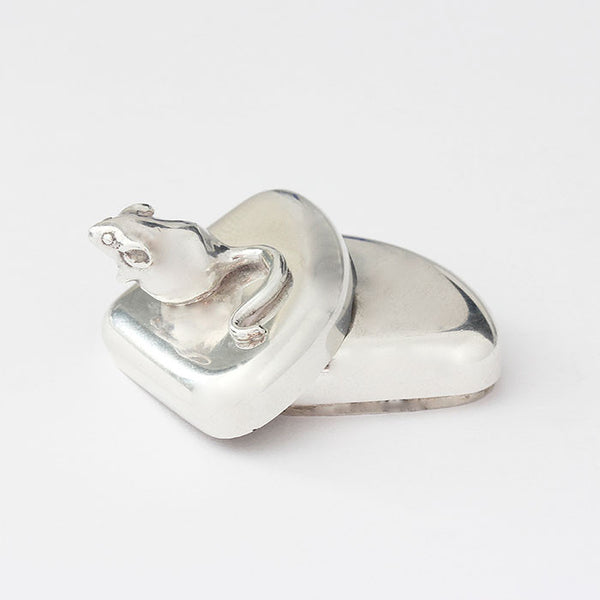 small silver box with a mouse on top triangular shaped box